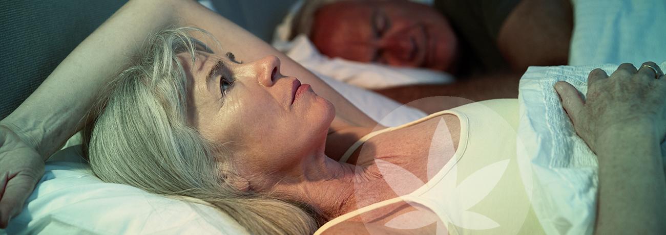Woman laying in bed awake